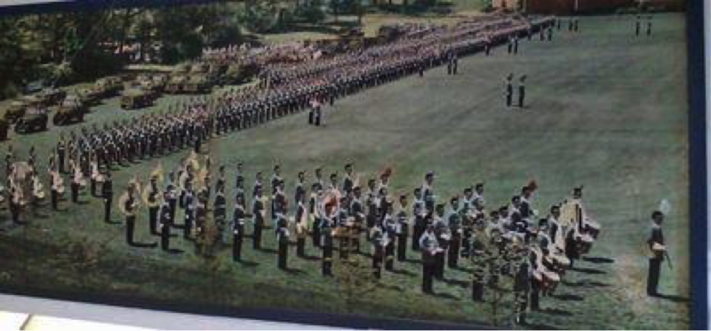 The Regimental Band and the Corps of Cadets in 1962 on the Parade Field before it received the Black Top